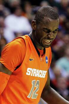Syracuse center Baye Keita (12) walks across the court after receiving a cut on his forehead after a fall during the first half of an East Regional semifinal in the NCAA college basketball tournament against Indiana, Thursday, March 28, 2013, in Washington. (AP Photo/Pablo Martinez Monsivais) Photo: Pablo Martinez Monsivais, Associated Press / AP