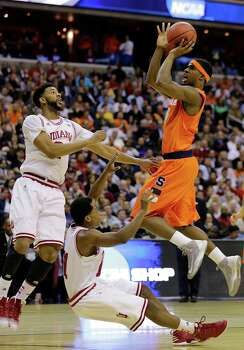 Syracuse forward C.J. Fair (5) shoots over Indiana forward Christian Watford (2) and guard Yogi Ferrell (11) during the first half of an East Regional semifinal in the NCAA college basketball tournament, Thursday, March 28, 2013, in Washington. (AP Photo/Alex Brandon) Photo: Alex Brandon, Associated Press / AP