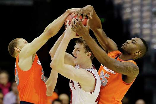 Indiana forward Cody Zeller (40) is trapped between Syracuse guard Brandon Trich, left, and forward Rakeem Christmas (25) during the first half of an East Regional semifinal in the NCAA college basketball tournament, Thursday, March 28, 2013, in Washington. (AP Photo/Alex Brandon) Photo: Alex Brandon, Associated Press / AP