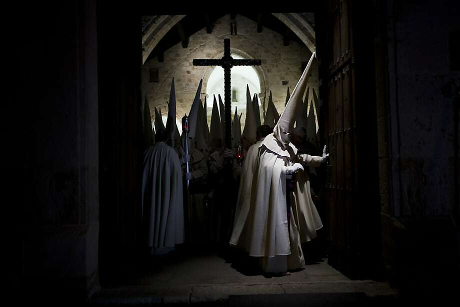 Penitents of the Jesus Yacente brotherhood take part in a Holy Week procession in Zamora, northern Spain, Thursday, March 28, 2013. Hundreds of processions take place throughout Spain during the Easter Holy Week. (AP Photo/Daniel Ochoa de Olza) Photo: Daniel Ochoa De Olza, Associated Press