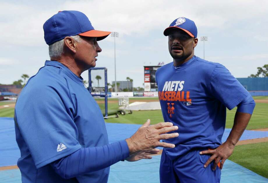 FILE - In this March 6, 2013, file photo, New York Mets manager Terry Collins, left, talks to pitcher Johan Santana before the Mets' exhibition baseball game against Venezuela in Port St. Lucie, Fla. The Mets say Santana has injured his left shoulder again and likely will need surgery and miss the 2013 season. (AP Photo/Julio Cortez, File) Photo: Julio Cortez