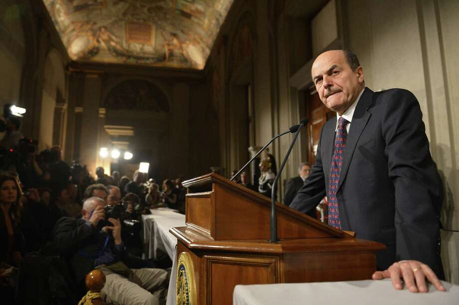 Leftist Pier Luigi Bersani announces to an assembled news conference that he has lost a bid to form a new government, after his meeting with President Giorgio Napolitano at the Quirinale, the Italian presidential palace in Rome. Photo: Alberto Pizzoli /