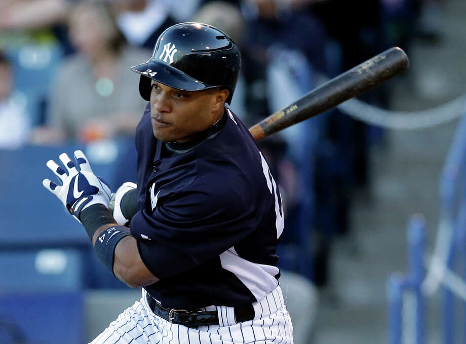 FILE - In this March 21, 2013, file photo, New York Yankees Robinson Cano bats during a spring training baseball game in Tampa, Fla. Now that Alex Rodriguez, Mark Teixeira, Curtis Granderson and Derek Jeter are out of the lineup, Cano is the man on the Yankees.  (AP Photo/Kathy Willens, File) Photo: Kathy Willens