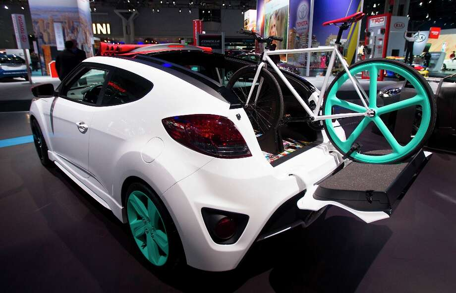 A bicycle sits mounted in the back of a Hyundai Motor Corp. 2013 Veloster Turbo vehicle displayed at the company's booth during the 2013 New York International Auto Show. Photo: Jin Lee, Bloomberg / © 2013 Bloomberg Finance LP
