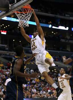 Wichita State 72, La Salle 58LOS ANGELES, CA - MARCH 28:  Tekele Cotton #32 of the Wichita State Shockers goes up for a dunk in the second half while taking on the La Salle Explorers during the West Regional of the 2013 NCAA Men's Basketball Tournament at Staples Center on March 28, 2013 in Los Angeles, California. Photo: Jeff Gross, Getty Images / 2013 Getty Images