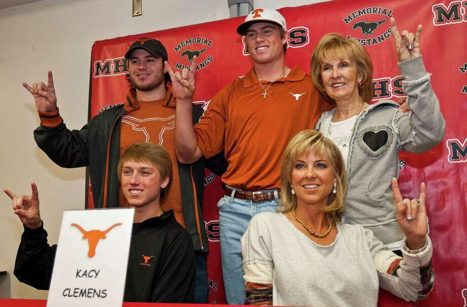 Kacy Clemens, top center, takes a picture with his family during a ceremony for his intent to attend Texas on a baseball scholarship, Wednesday, Nov. 14, 2012, in Memorial High School in Houston. His brother Kody Clemens, top left, grandmother Jan Wilde, top right, brother Koby Clemens, bottom left, and mother Debbie Clemens. ( Nick de la Torre / Houston Chronicle ) Photo: Nick De La Torre, Staff / © 2012  Houston Chronicle