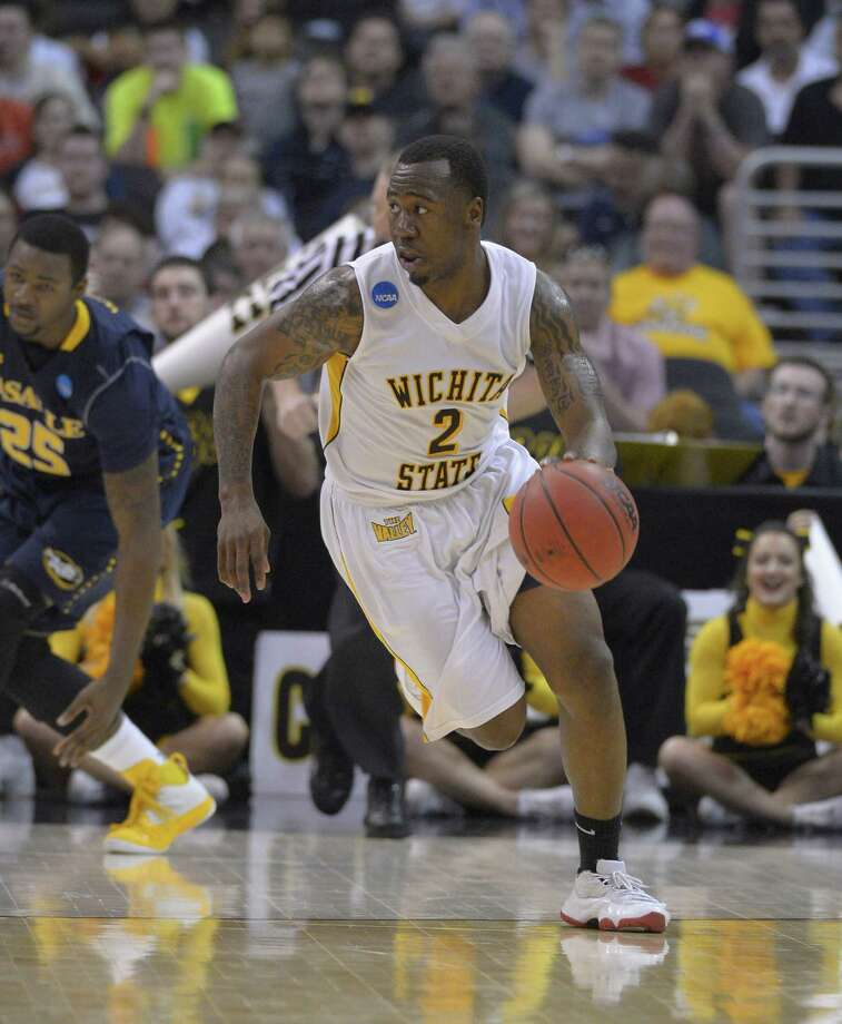 Wichita State's Malcolm Armstead (2) moves the ball against La Salle during the first half of a West Regional semifinal in the NCAA college basketball tournament, Thursday, March 28, 2013, in Los Angeles. (AP Photo/Mark J. Terrill) Photo: Mark J. Terrill, Associated Press / AP