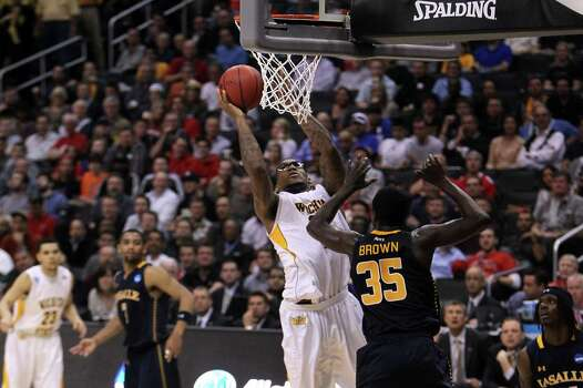 LOS ANGELES, CA - MARCH 28:  Carl Hall #22 of the Wichita State Shockers goes up for a shot against Rohan Brown #35 of the La Salle Explorers in the first half during the West Regional of the 2013 NCAA Men's Basketball Tournament at Staples Center on March 28, 2013 in Los Angeles, California. Photo: Jeff Gross, Getty Images / 2013 Getty Images