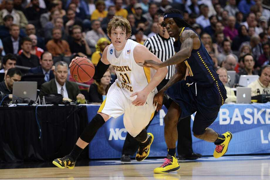 LOS ANGELES, CA - MARCH 28:  Ron Baker #31 of the Wichita State Shockers drives on Tyrone Garland #21 of the La Salle Explorers in the first half during the West Regional of the 2013 NCAA Men's Basketball Tournament at Staples Center on March 28, 2013 in Los Angeles, California. Photo: Harry How, Getty Images / 2013 Getty Images