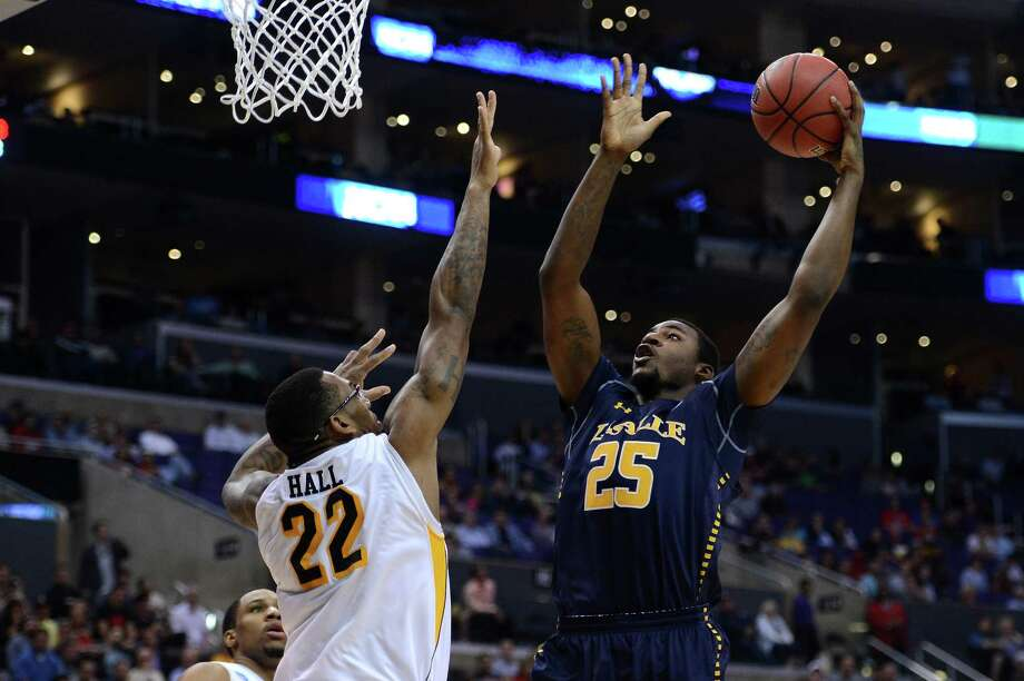 LOS ANGELES, CA - MARCH 28:  Jerrell Wright #25 of the La Salle Explorers goes up for a shot against Carl Hall #22 of the Wichita State Shockers in the second half during the West Regional of the 2013 NCAA Men's Basketball Tournament at Staples Center on March 28, 2013 in Los Angeles, California. Photo: Harry How, Getty Images / 2013 Getty Images