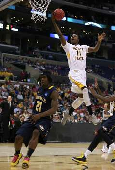 LOS ANGELES, CA - MARCH 28:  Cleanthony Early #11 of the Wichita State Shockers goes up for a shot over Tyrone Garland #21 of the La Salle Explorers in the second half during the West Regional of the 2013 NCAA Men's Basketball Tournament at Staples Center on March 28, 2013 in Los Angeles, California. Photo: Jeff Gross, Getty Images / 2013 Getty Images