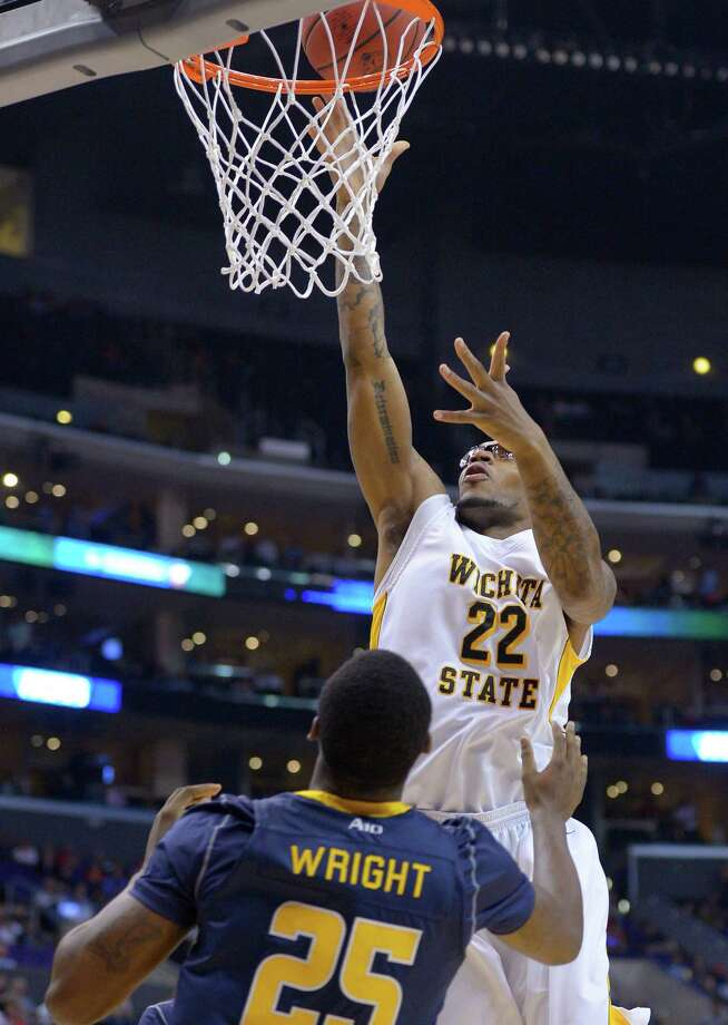 Wichita State's Carl Hall goes up for a basket as La Salle's Jerrell Wright watches during the first half of a West Regional semifinal in the NCAA men's college basketball tournament, Thursday, March 28, 2013, in Los Angeles. (AP Photo/Mark J. Terrill) Photo: Mark J. Terrill, Associated Press / AP