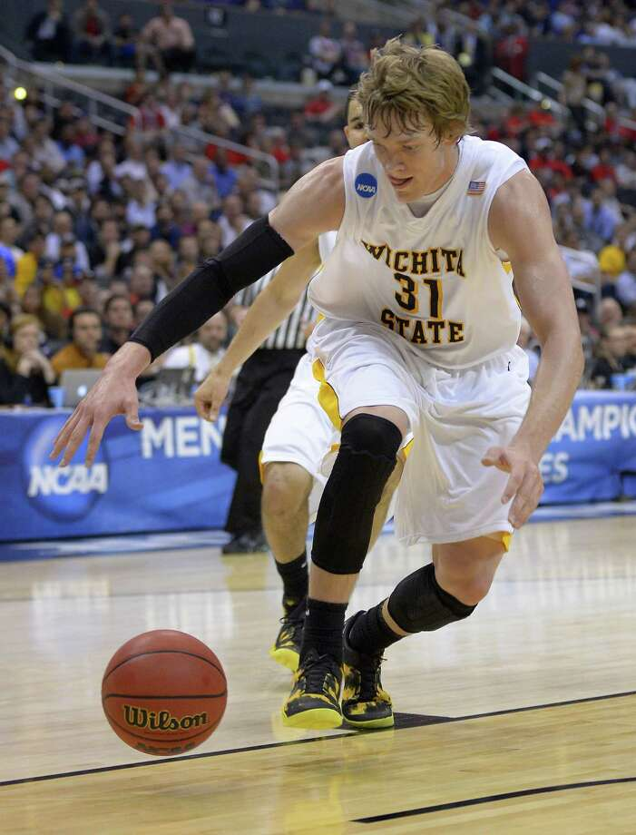 Wichita State's Ron Baker (31) reaches for a loose ball against La Salle during the first half of a West Regional semifinal in the NCAA men's college basketball tournament, Thursday, March 28, 2013, in Los Angeles. (AP Photo/Mark J. Terrill) Photo: Mark J. Terrill, Associated Press / AP