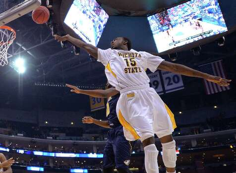 Wichita State's Nick Wiggins (15) shoots against La Salle guard Sam Mills during the first half of a West Regional semifinal in the NCAA men's college basketball tournament, Thursday, March 28, 2013, in Los Angeles. (AP Photo/Mark J. Terrill) Photo: Mark J. Terrill, Associated Press / AP