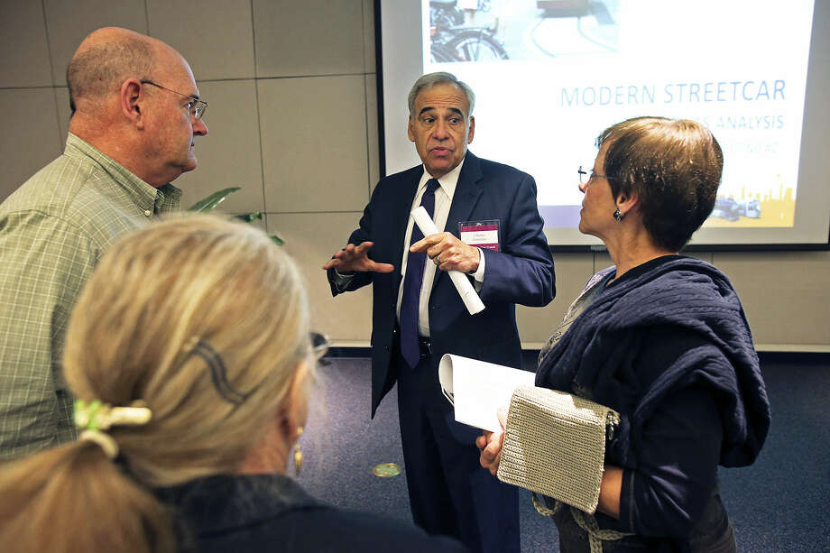 Former Congressman Charlie Gonzalez, VIA's new chief of public engagement, talks with Chip Henderson (from left), Betty Eckert and Lynn Knapik after potential streetcar routes were presented to the public. Photo: Tom Reel / San Antonio Express-News