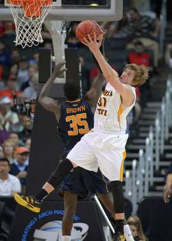 Wichita State's Ron Baker (31) vies for a rebound with La Salle's Rohan Brown (35) during the first half of a West Regional semifinal in the NCAA men's college basketball tournament, Thursday, March 28, 2013, in Los Angeles. (AP Photo/Mark J. Terrill) Photo: Mark J. Terrill, Associated Press / AP