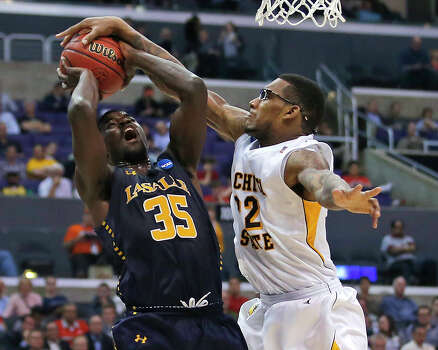 Wichita State's Carl Hall (22) blocks an attempted shot by La Salle's Rohan Brown during the first half of a West Regional semifinal in the NCAA men's college basketball tournament, Thursday, March 28, 2013, in Los Angeles. (AP Photo/Jae C. Hong) Photo: Jae C. Hong, Associated Press / AP