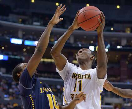 Wichita State's Cleanthony Early (11) takes aim over La Salle defender Sam Mills during the first half of a West Regional semifinal in the NCAA men's college basketball tournament, Thursday, March 28, 2013, in Los Angeles. (AP Photo/Mark J. Terrill) Photo: Mark J. Terrill, Associated Press / AP