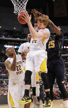 Wichita State's Ron Baker pulls down a rebound in front of La Salle's Jerrell Wright (25) during the first half in NCAA Tournament Sweet 16 action at Staples Center in Los Angeles, California, on Thursday, March 28, 2013. (Jaime Green/Wichita Eagle/MCT) Photo: Jaime Green, McClatchy-Tribune News Service / Wichita Eagle