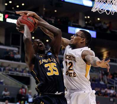 La Salle's Rohan Brown (35) has his shot blocked by Wichita State's Carl Hall during the first half in NCAA Tournament Sweet 16 action at Staples Center in Los Angeles, California, on Thursday, March 28, 2013. (Yong Kim/Philadelphia Daily News/MCT) Photo: Yong Kim, McClatchy-Tribune News Service / Philadelphia Daily News