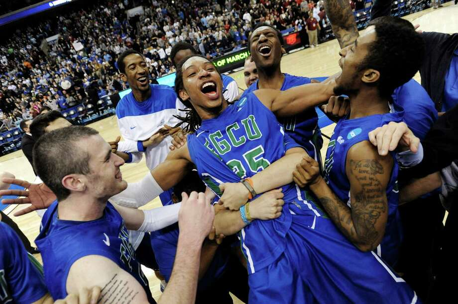 In this March 24, 2013, file photo, Florida Gulf Coast's Sherwood Brown, center, celebrates with teammates after their 81-71 win over San Diego State in a third-round game in the NCAA college basketball tournament in Philadelphia. Florida Gulf Coast became the first No. 15 seed to make the Sweet 16. (AP Photo/Michael Perez, File) Photo: Michael Perez, Associated Press / FR168006 AP