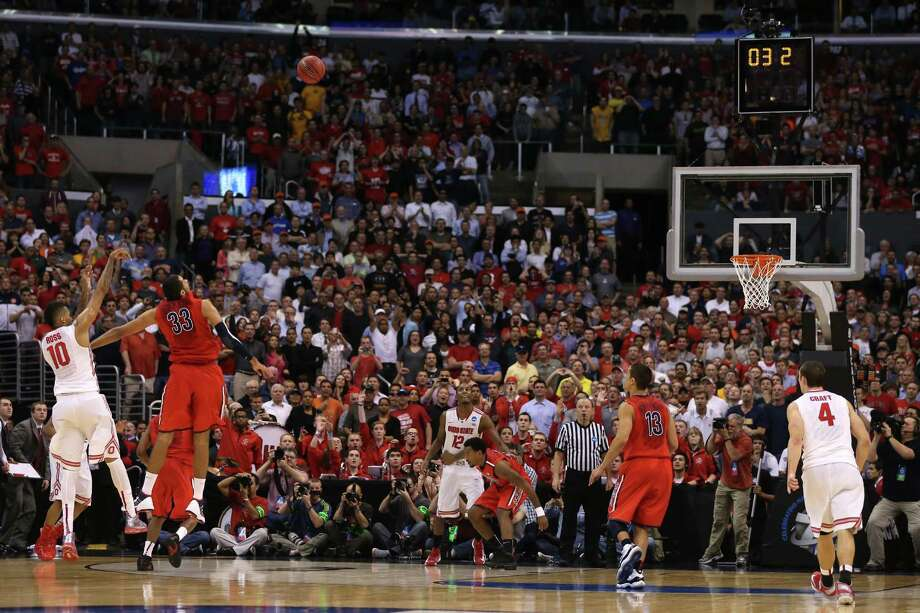 Ohio State's LaQuinton Ross (left) watches as his 3-point attempt over Arizona's Grant Jerrett in the final seconds, which lifted the Buckeyes to the Elite Eight. Photo: Jeff Gross / Getty Images