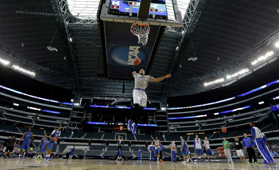 Florida Gulf Coast's Sherwood Brown dunks during practice for a regional semifinal game in the NCAA college basketball tournament, Thursday, March 28, 2013, in Arlington, Texas. Florida Gulf Coast faces Florida on Friday. (AP Photo/David J. Phillip) Photo: David J. Phillip