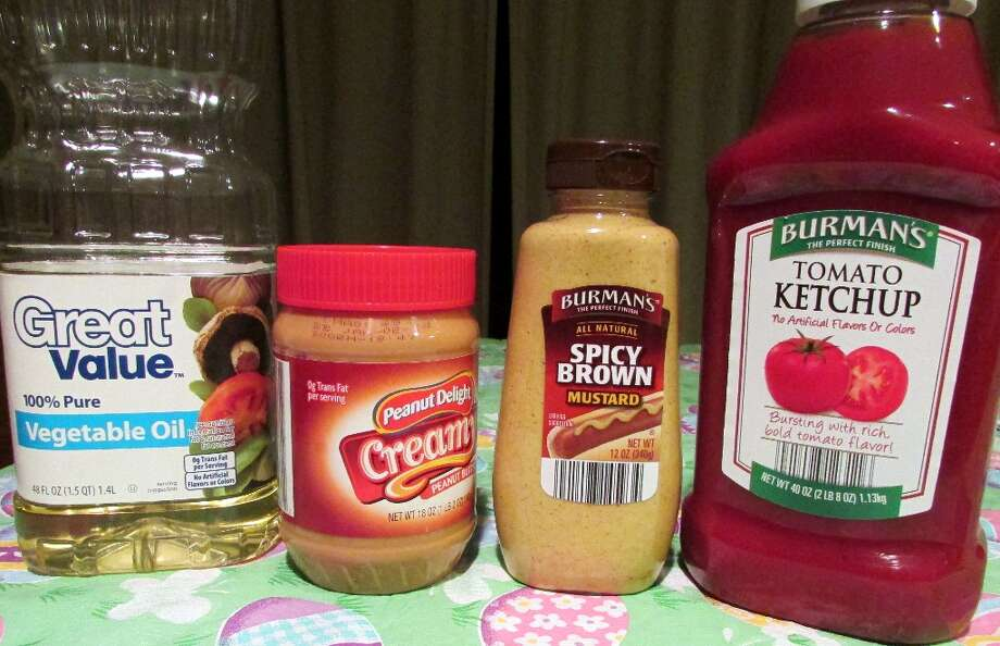 Multiple condiments, oils and peanut butter jars are made with Plastic #1 and should also not be kept in heated areas. Photo by Erik DeFruscio. Photo: Picasa