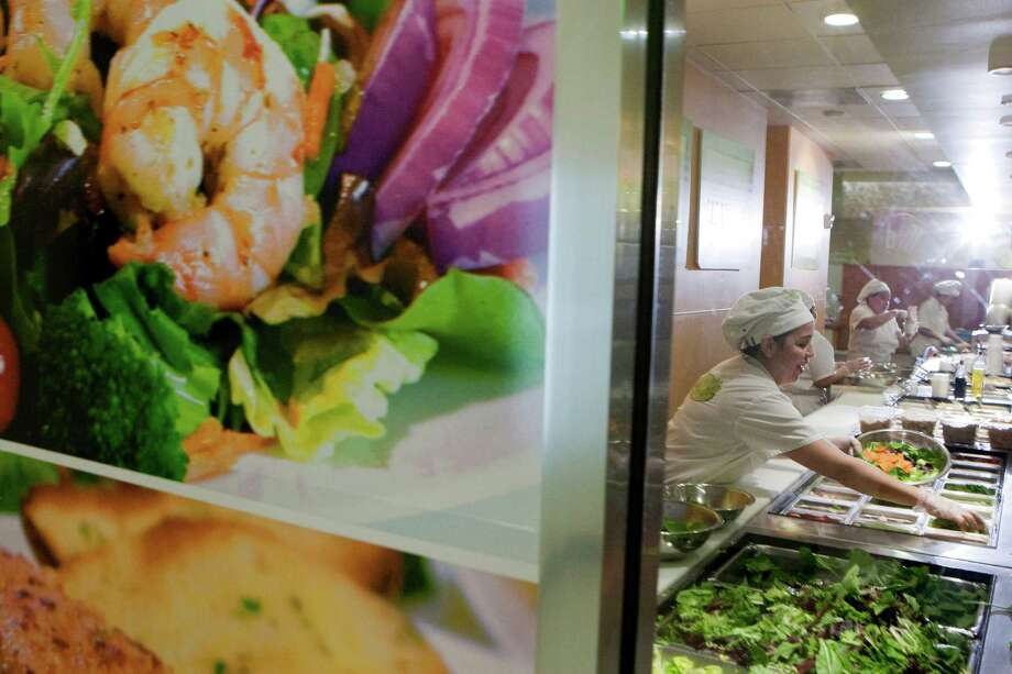 Salads are prepared at Salata at 919 Milam. The owners have invested more than $1 million, according to a report by the Chronicle's David Kaplan.More: Chain's business is mushrooming Photo: Johnny Hanson, Houston Chronicle / © 2013  Houston Chronicle