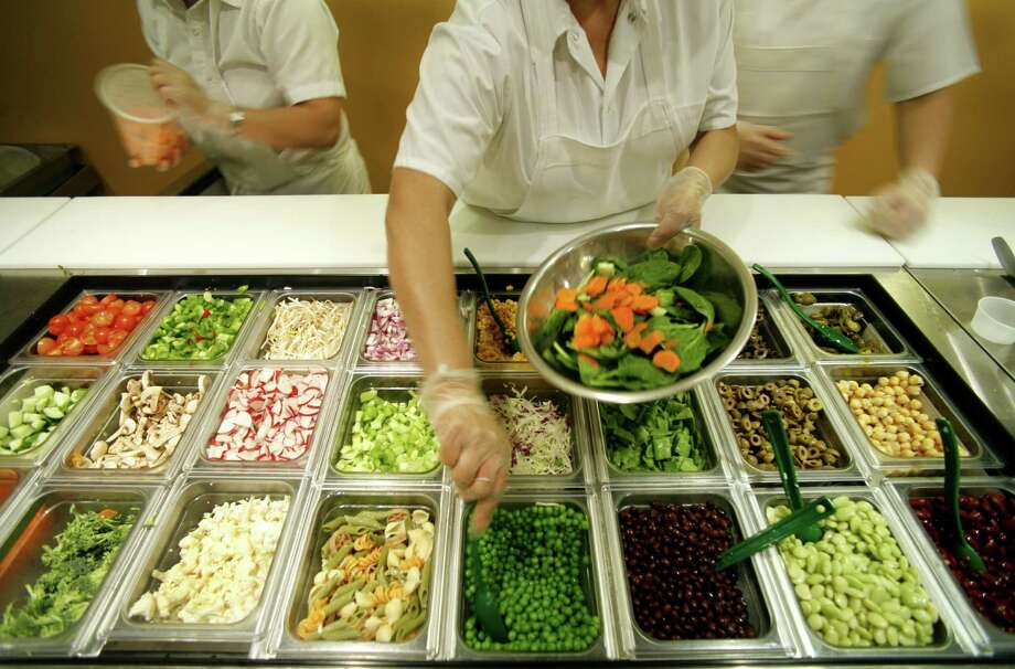 A salad is prepared for a lunch customer. Photo: Steve Ueckert, Houston Chronicle / Houston Chronicle