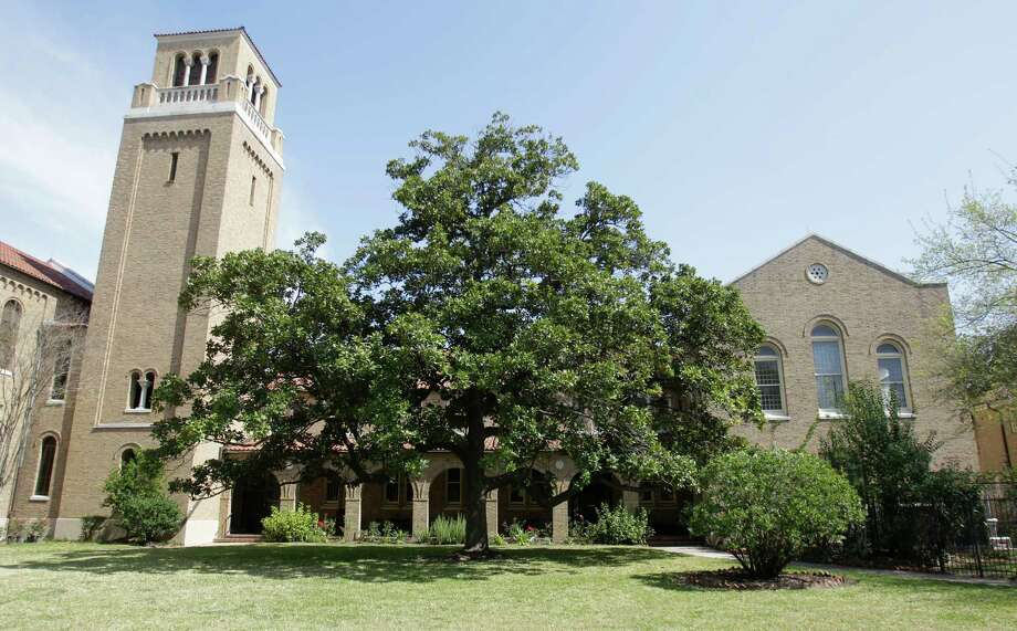 A venerable magnolia tree stands watch outside the 86-year-old First Evangelical Lutheran Church. The congregation returns to the building on Sunday. • More: Church has much to celebrate Photo: Melissa Phillip, Houston Chronicle / © 2013  Houston Chronicle