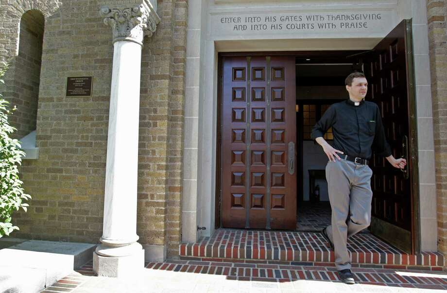 The Rev. Evan McClanahan discusses the renovations. • More: Church has much to celebrate Photo: Melissa Phillip, Houston Chronicle / © 2013  Houston Chronicle