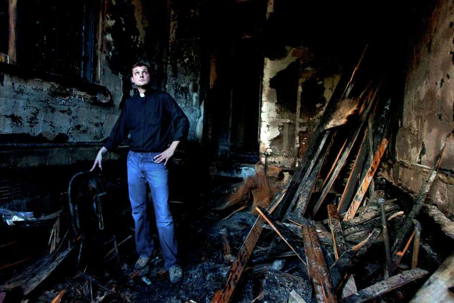 Pastor Evan McClanahan looks at the remains of the sacristy room. Photo: Cody Duty, Houston Chronicle / © 2011 Houston Chronicle