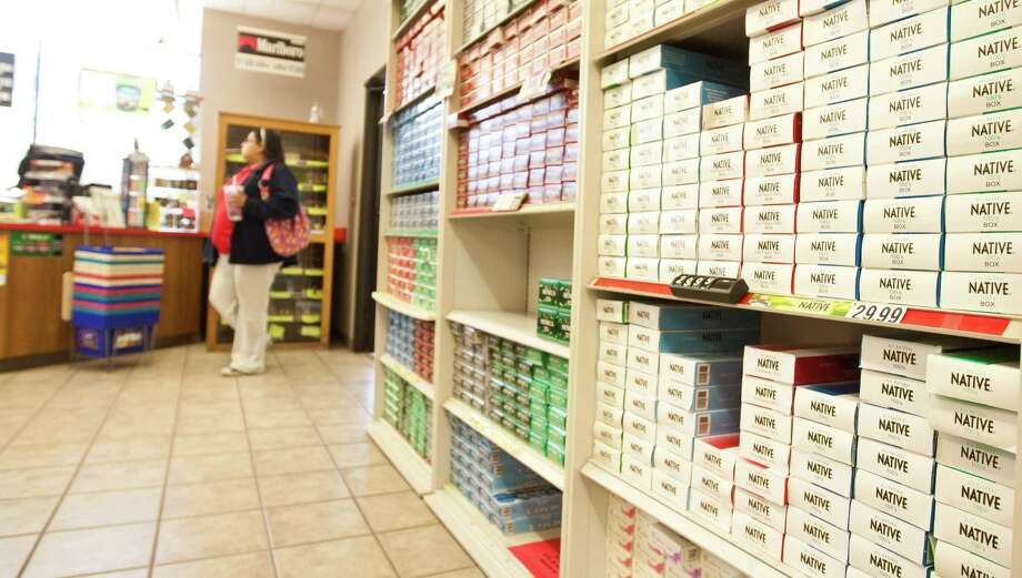 A shopper checks out the Alabama-Coushatta Tribe's Smoke House. About 85 percent of the tribe's current revenue comes from a $10 carton tax — $4 less than the state tax — at two smoke shops. Photo: Nick De La Torre, Chronicle / © 2013 Houston Chronicle