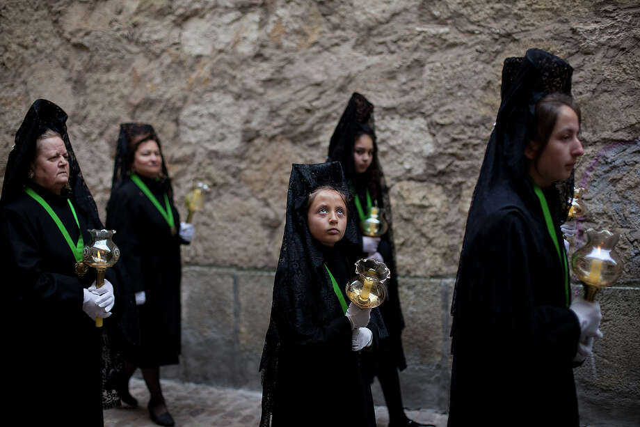 Penitents wearing  mantillas walk the streets during the Holy Week procession of the Cofradia de la Virgen de la Esperanza on March 28, 2013 in Zamora, Spain. Easter week is traditionally celebrated with processions in most Spanish towns. Photo: Pablo Blazquez Dominguez, Getty Images / 2013 Getty Images