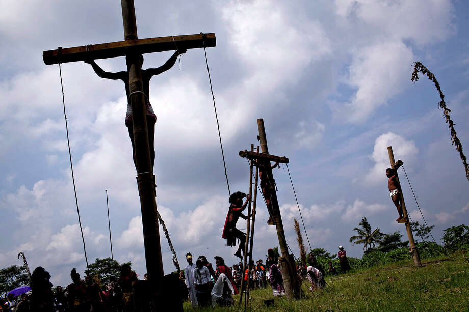 Indonesian Catholics participate in a re-enactment of the crucifixion of Jesus Christ on Good Friday on March 29, 2013 in Magelang, Central Java, Indonesia. Catholics make up approximately 3% of the population of the predominantly Muslim country. Photo: Ulet Ifansasti, Getty Images / 2013 Getty Images