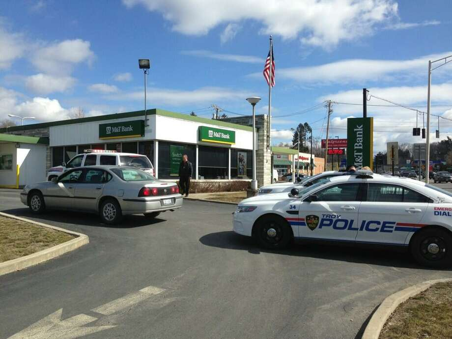 Police are at the scene of a bank robbery Friday at the M&T bank on Hoosick Street in Troy. (Skip Dickstein/Times Union)
