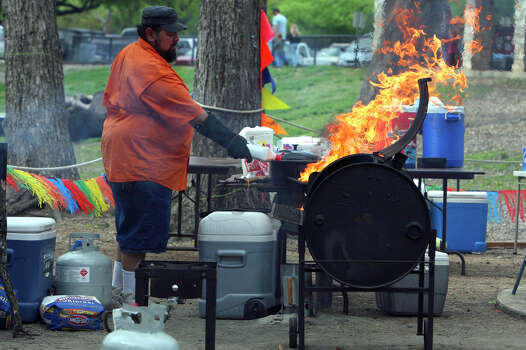 Richard Gomez gets his barbecue grill fired up on Easter morning, 2010, at Brackenridge Park. Families loaded up their grills and tents to stake out spots at the park for the annual Easter festivities at there. Photo: JOHN DAVENPORT, SAN ANTONIO EXPRESS-NEWS / jdavenport@express-news.net