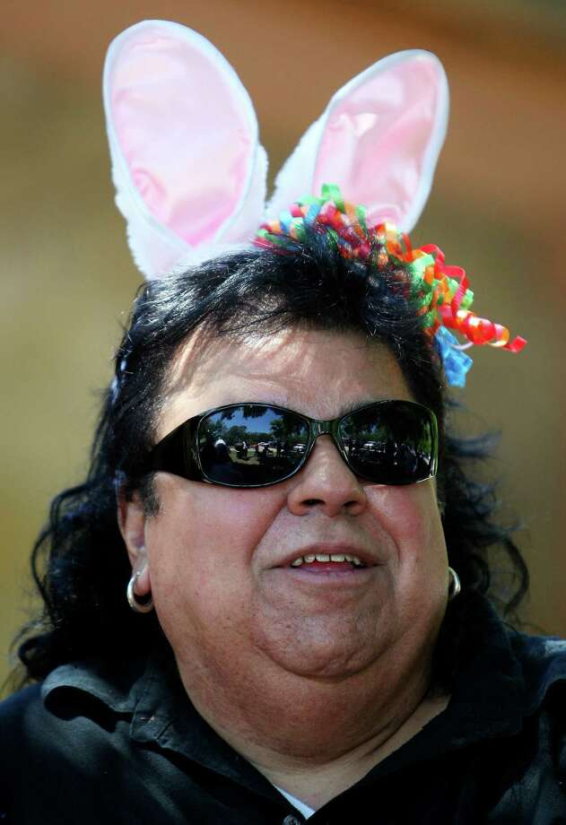 Al Zaldivar wears rabbit ears while spending Easter Sunday April 12, 2009 at Brackenridge Park. Photo: EDWARD A. ORNELAS, SAN ANTONIO EXPRESS-NEWS / eaornelas@express-news.net