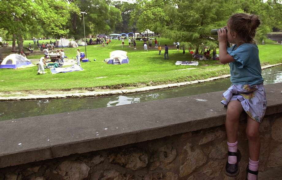 Brianna Pansza, 4, looks through her binoculars as she searches for people hiding their Easter eggs at Brackenridge Park in 2001. Photo: DELCIA LOPEZ, SAN ANTONIO EXPRESS NEWS / SAN ANTONIO EXPRESS-NEWS
