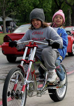 Easter morning finds Brackenridge Park full of campers, families preparing for Sunday picnics and folks working on staying warm in the face of a chilling wind. Here, manageing to stay warm, Roger Rubio, 9, gives his sister Rosalinda Rubio, 5, a ride on his chopper bicycle. 03/27/05 Photo: J. MICHAEL SHORT, SPECIAL TO THE EXPRESS-NEWS / SAN ANTONIO EXPRESS-NEWS