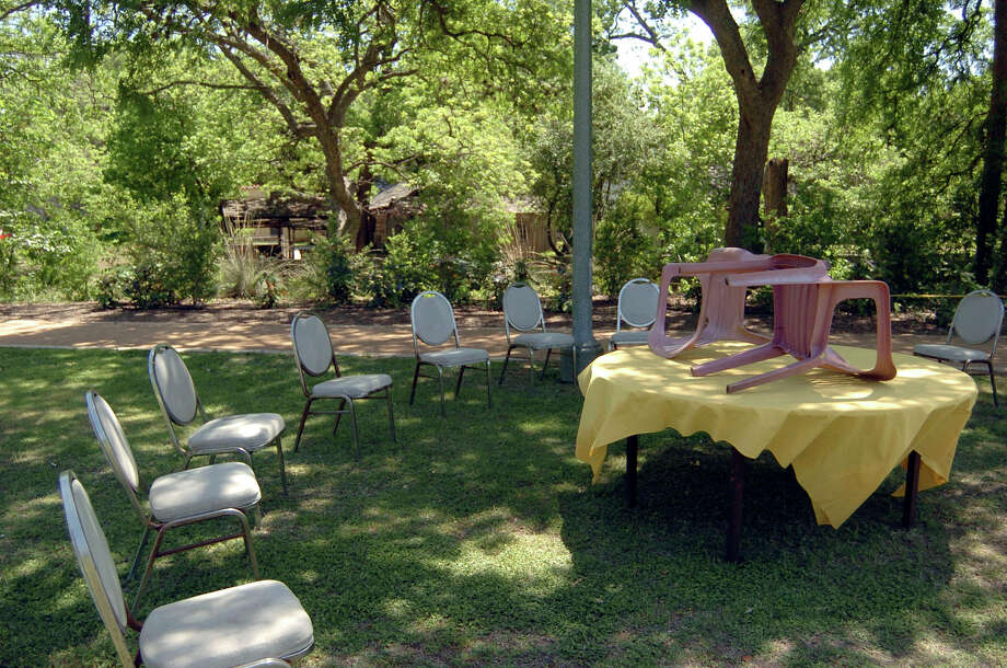 Chairs and a table mark the spot where a family has staked out their territory in Brackenridge Park in preparation for Sunday's Easter outing in 2006. Some families began staking out their spots one week ago.  Photo: BILLY CALZADA, SAN ANTONIO EXPRESS-NEWS / SAN ANTONIO EXPRESS-NEWS