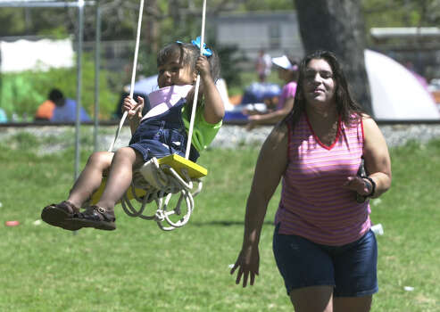 Molly Solis, 3, gets a push from her aunt Linda Rubio as families enjoy Easter picnics at Brackenridge Park Easter Sunday March 31, 2002.  Photo: ROBERT MCLEROY, SAN ANTONIO EXPRESS-NEWS / SAN ANTONIO EXPRESS-NEWS