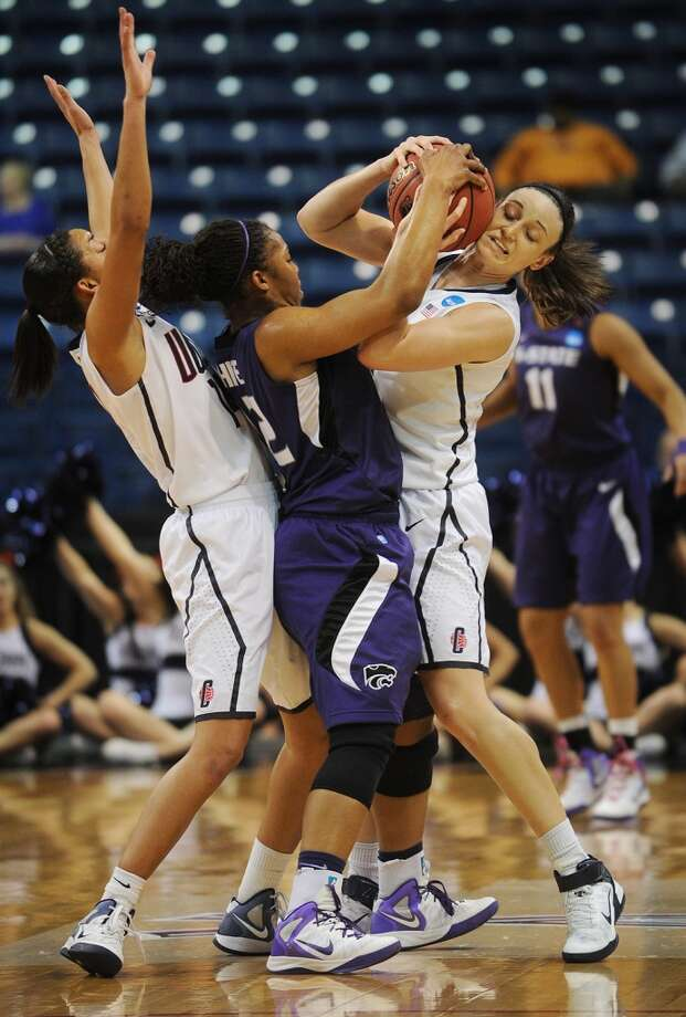 Kansas State's Mariah White, center, is tied up by UConn's Kelly Faris, right, after being double teamed by Faris and Bria Hartley, left,  in the second round of the NCAA women's basketball tournament at the Webster Bank Arena in Bridgeport on Monday, March 19, 2012.