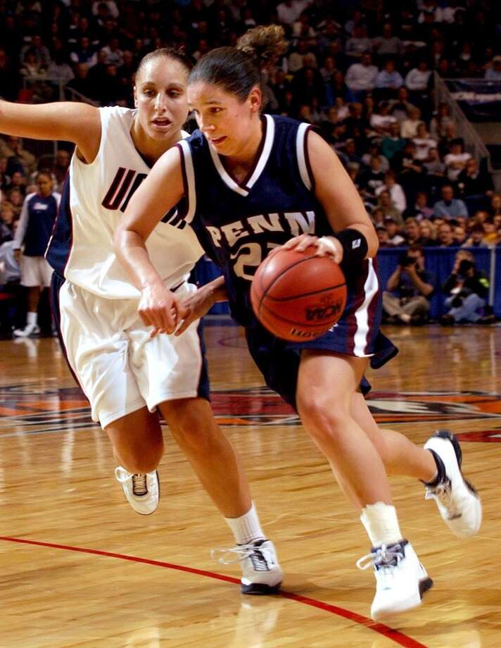 Bridgeport_032104_ University of Connecticut vs. PENN in first round NCAA women's basketball tournament.  (L) UConn's #3, Diana Taurasi defends Penn's #22, Mikelyn Austin. Paul Desmarais/Staff photo