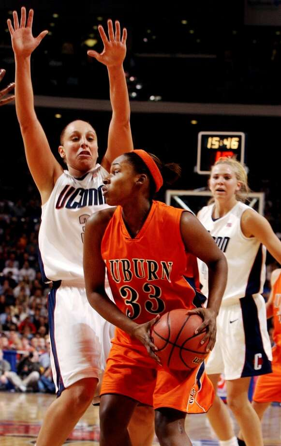 Bridgeport_032304_ University of Connecticut vs. Auburn University in the second round of the NCAA women's basketball tournament. Nitasha Brackett, Auburn, tries to get by Diana Taurasi, UCONN, in the first half of game. Paul Desmarais/Staff photo