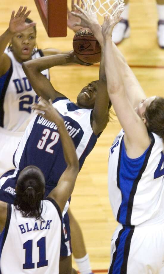 Bridgeport_032806_ UConn's Kalana Greene, center, is surrounded by Duke's Monique Currie, top, Chante Black, bottom, and Abby Warner, right during The University of Connecticut versus Duke during the 2006 NCAA Tournament Bridgeport Regional basketball tournament at the Arena at Harbor Yard in Bridgeport, Conn. on Tuesday, March 28, 2006. Chris Preovolos/Stamford Advocate