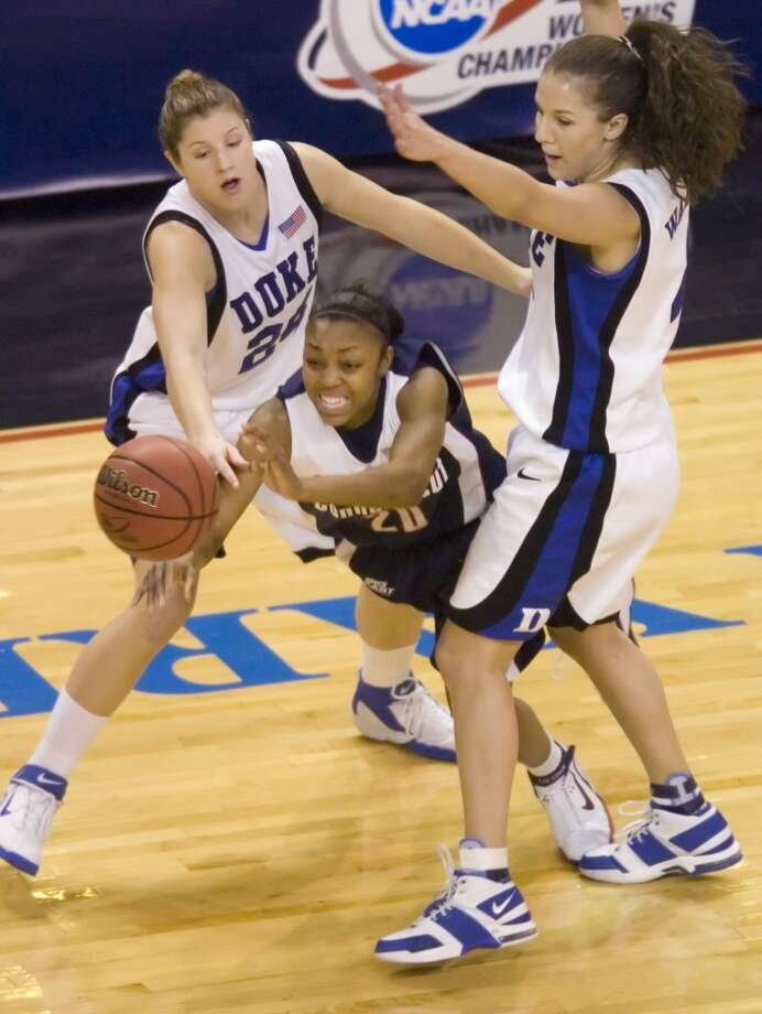 Bridgeport_032806_ UConn's Renee Montgomery, center, Jessica Foley, left, and Abby Waner, right during The University of Connecticut versus Duke during the 2006 NCAA Tournament Bridgeport Regional basketball tournament at the Arena at Harbor Yard in Bridgeport, Conn. on Tuesday, March 28, 2006. Chris Preovolos/Stamford Advocate