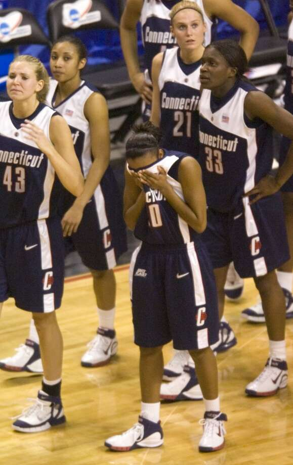 Bridgeport_032806_ Renee Montgomery, center, and the UConn women after their loss. The University of Connecticut versus Duke during the 2006 NCAA Tournament Bridgeport Regional basketball tournament at the Arena at Harbor Yard in Bridgeport, Conn. on Tuesday, March 28, 2006. Chris Preovolos/Stamford Advocate
