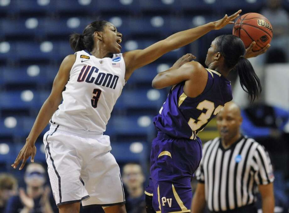 Connecticut's Tiffany Hayes, left, pressures Prairie View A&M's Kiara Etienne during the first half of an NCAA tournament first-round college basketball game in Bridgeport, Conn., Saturday, March 17, 2012. Connecticut won 83-47. (AP Photo/Jessica Hill)